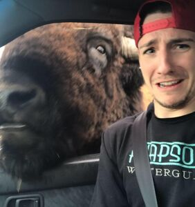 WATCH: Sexy gay nature lover has hilariously close call with Buffalo