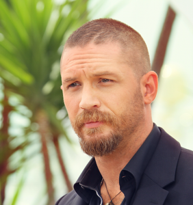WATCH: Tom Hardy bends his stunt double over and lets him have it