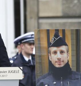Husband of slain officer from Paris attack delivers heartbreaking eulogy