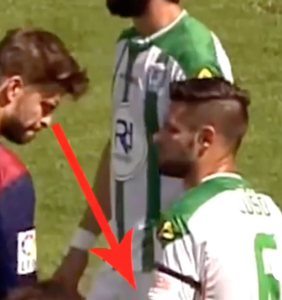 Hunky soccer player Gerard Piqué distracted by opponent's huge… you get it