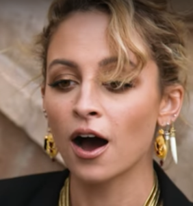 Painful: Interviewer slaps the sunglasses right off Nicole Richie's face