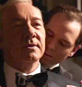 Who's this man nuzzling Kevin Spacey's neck?