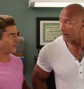 "Zac Efron and The Rock share a kiss in new ""Baywatch"" red-band trailer"