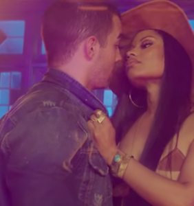 "Joe Jonas and Nicki Minaj sex each other up in DNCE's ""Kissing Strangers"" vid"