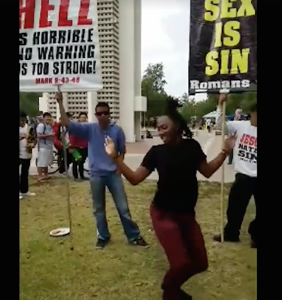 Student shuts down angry antigay protestors by voguing at them in must-see video