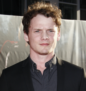 Anton Yelchin plays a struggling gay son in his final film, 'We Don't Belong Here'