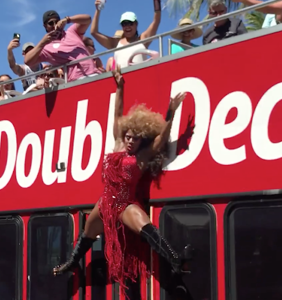 This drag queen leapt off a double-decker bus to do a full-on split, and whoa. Just whoa.
