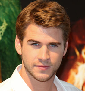 Liam Hemsworth just posted a pic in a tiny Speedo — because he loves you.