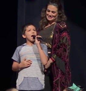 Young boy in the front row out-divas Idina Menzel, and she's living for it