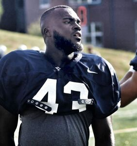 This college football star grabbed a mic, hopped on stage, and came out to his entire team