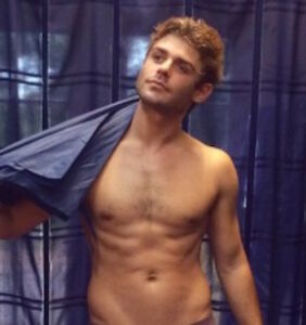 Garrett Clayton models an umbrella, but fans are looking elsewhere