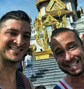 Gay couple who flashed their butts at Thai temples is now royally screwed