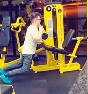 Um, what is that man doing to that weight machine?