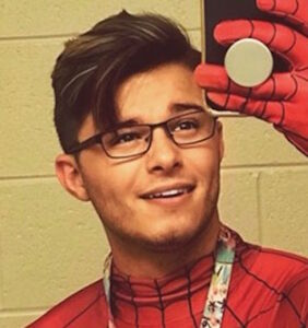 Can you figure out why this handsome teacher's Spider-Man costume is going viral?