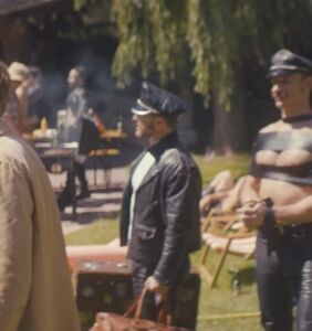 "Something very distracting is going down in the background of this ""Tom of Finland"" clip"