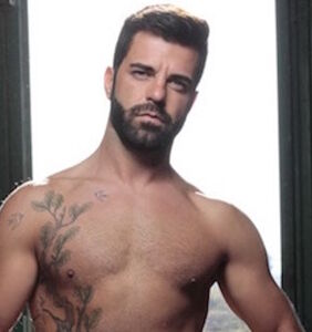 Gay adult film star Hector De Silva shows off his steed