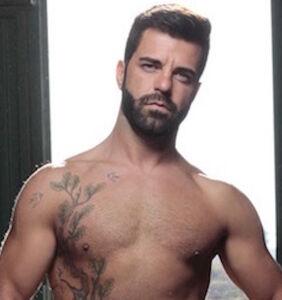 Gay adult film star Hector De Silva shows off his steed