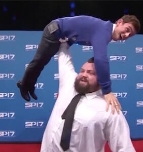 The world's strongest man just lifted Tom Daley like he was the littlest bug; the smallest worm