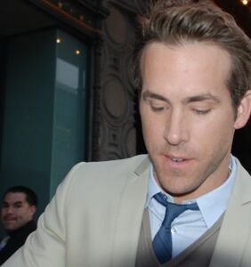 """Ryan Reynolds gifts fans a """"well hung"""" look at his latest project"""