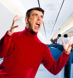 Passengers look on in disgust as living embodiment of toxic masculinity tries to exit plane