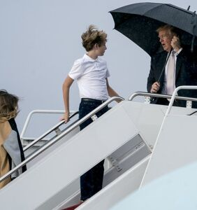 Donald Trump hogs umbrella, leaves family exposed to elements on wet, frigid tarmac