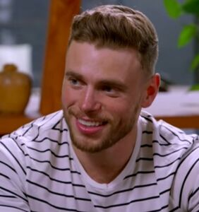 Why is Gus Kenworthy communing with the dead?