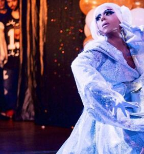 Guess which megastar was snapped at a gay bar living for 'Drag Race' queens?