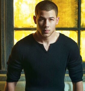 Nick Jonas shows off a whole lot more than his golf swing in super-tight pants