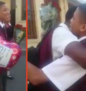 WATCH: Schoolboys celebrate Valentine's Day with a kiss as peers cheer in support