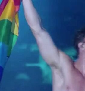 Which shirtless Mormon superstar just waved a Pride flag for a massive crowd?