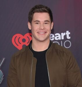WATCH: Adam DeVine screens his explicit Netflix scene for his dad as they compare sizes
