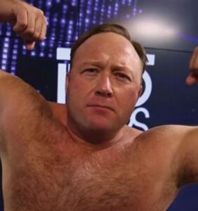 Alex Jones busted on air for watching x-rated video starring trans woman