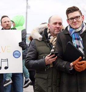 Over 100 people show up to support gay teacher who was scolded when his husband sent him flowers