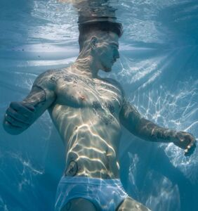 Stripping down for underwater photographer just in time for Toronto Pride