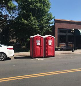 Man has homophobic meltdown over two port-a-potties placed outside his restaurant during Pride