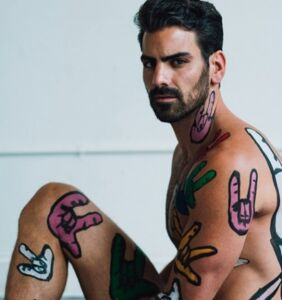 Nyle DiMarco is naked and covered in sign language