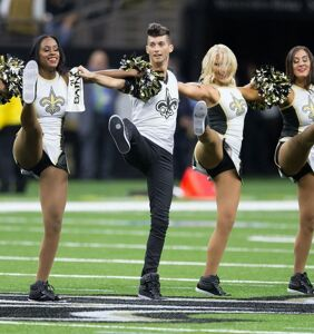 NFL's first male cheerleader totally slays in debut performance, is met with cheers… and jeers