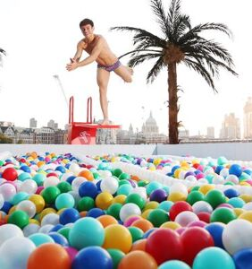 The world is Tom Daley's playground as he dives into a pool of balls