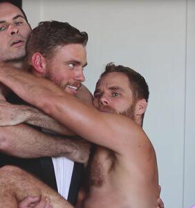 Gus Kenworthy caught in a man-sandwich with boyfriend Matt Wilkas and another man