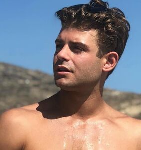 Garrett Clayton spills major tea on the career advisor who told him to stay closeted