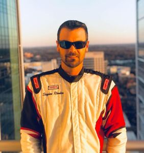 First openly gay NASCAR driver talks racing, homophobic fans, and vodka cranberries