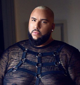 This gay, plus-size model is challenging stereotypes around male beauty and succeeding