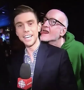 Gay reporter files police report after having ear licked by slobbering comedian on live TV