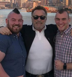 Arnold Schwarzenegger is the meat (beef?) in this gay wedding sandwich