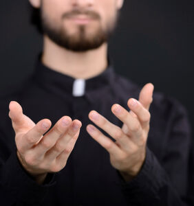 """Priest busted for making """"demonic"""" BDSM bisexual threesome video on church altar"""