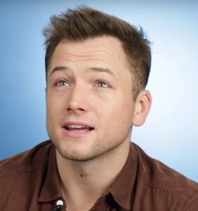 Watch the exact moment Taron Egerton learns about gay sex slang