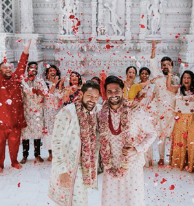 """People are gushing over these """"twinning grooms"""" who were just married in a traditional Hindu ceremony"""