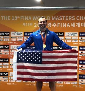 Gay diver becomes world masters champ with husband