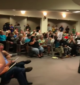 """Watch a roomful of people laugh in the face of a """"Straight Pride"""" organizer"""