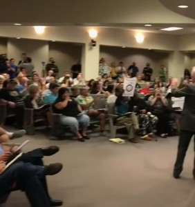 "Watch a roomful of people laugh in the face of a ""Straight Pride"" organizer"